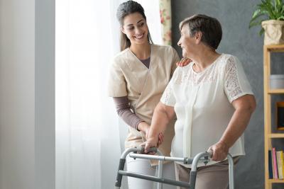caregiver assisting senior woman at home