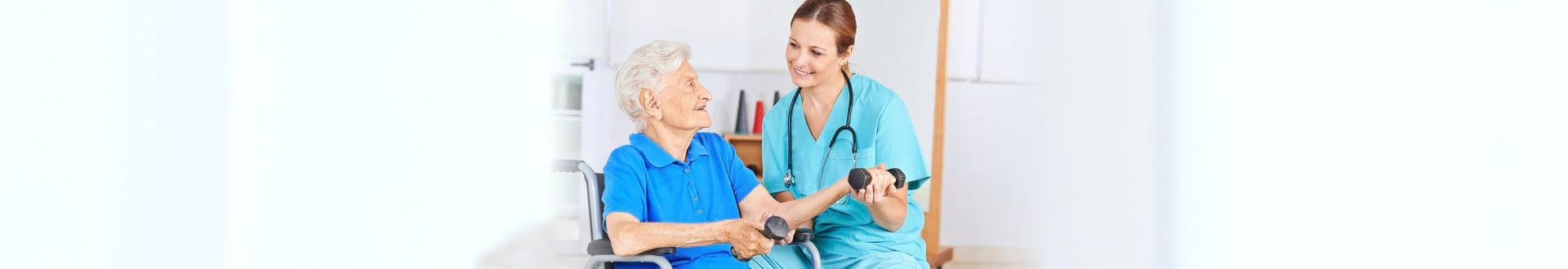 female medical staff assisting senior woman